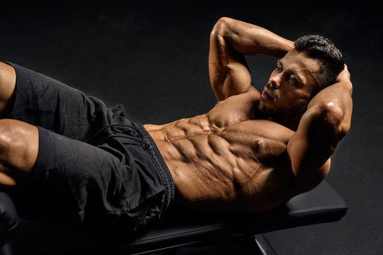 Man training abs on mat.