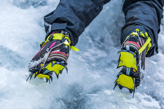 Closeup of Hiking Boots with Mounted Crampons used for Ice Climbing