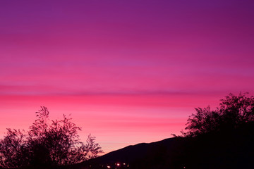 Pop Art Style Silhouette of Hill and Trees Against Dreamy Purple Pink Sky