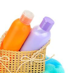 Shampoo, liquid soap and washcloth isolated on a white background.