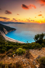 Beautiful summer sunset on Mirtos beach in Greece