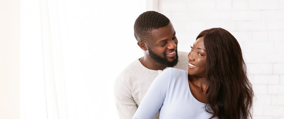 Just married afro couple posing over white background Papier Peint