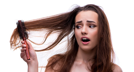 Woman in beauty concept combing hair loosig loss