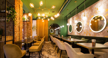Light modern interior of urban restaurant or cafe with dining places