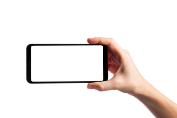 Woman holding smartphone with empty screen isolated on white background. Female hand with phone, space for text
