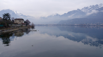 Pescate, Lecco, Lombardy, Italy, January 18, 2020 - View on the northern side of the lake Garlate, which is connected to the lake Como through the river Adda at the foot of the Alps.