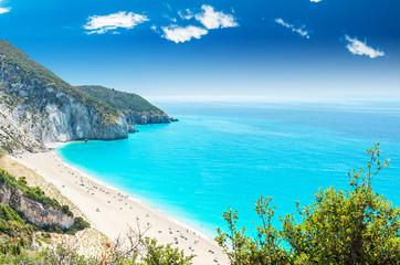 Milos beach on Lefkada island, Greece. Mylos beach near the Agios Nikitas village on Lefkada, Greece. People relaxing at the beach