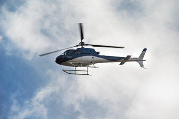 Foto op Plexiglas Helicopter helicopter in the sky with clouds