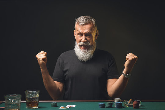 Emotional mature man after losing at poker in casino