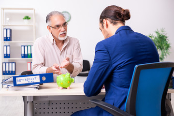 Financial advisor giving retirement advice to old man