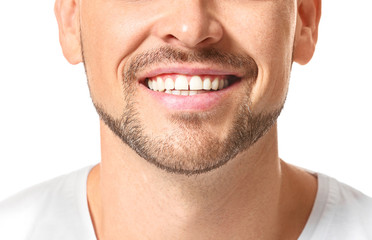 Handsome man with healthy teeth on white background, closeup Fotomurales