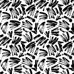 Black painted brush strokes seamless vector pattern. Black brushstrokes on a white background.