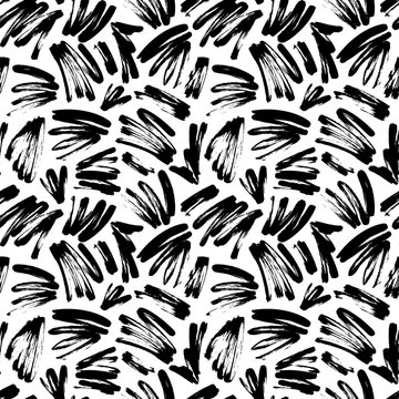 Black painted brush strokes seamless vector pattern. Black brushstrokes on a white background.