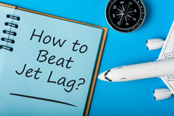 How to beat Jet Lag - Stop Jet Lag symbol with airplane and compas. Business travel concept