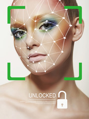 Biometric verification. Young woman. The concept of a technology of face recognition on polygonal grid