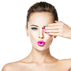 beautiful woman  with colored nails and fashion makeup