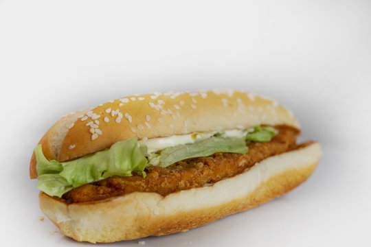 fried chicken burger, with lettuce and mayonnaise, on a white background, food concept