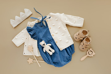 Knitted  jumper  with Blue romper and shoes, cotton crown and toys. Set of baby clothes and...