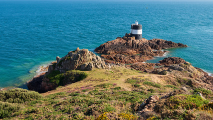 Noirmont Tower is painted black and white to serve as a daymark for sailors and houses a light