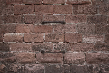Red brick wall with a metal ladder
