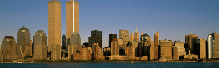 Wall Mural - This is the Manhattan skyline from Liberty Park, New Jersey at sunset. It shows the density of the buildings in downtown Manhattan.