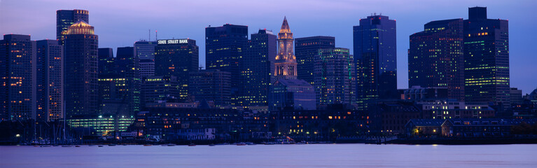 This is Boston Harbor and the skyline. It is the view from south Boston at dusk.