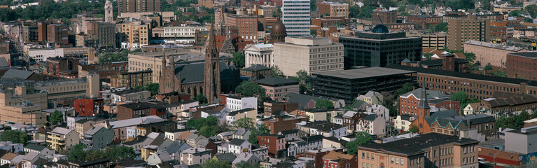 This is a congested urban landscape. It shows the elements of life of church, work, and home within the city limits.