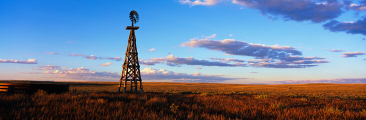 This is an old wooden windmill along Route 60. It is an RMotor windmill in sunset light. Fotomurales
