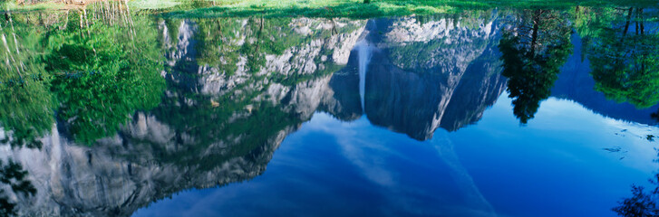 Wall Mural - This is a water reflection of Upper Yosemite Falls in the spring.