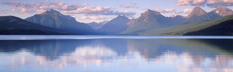 Wall Mural - This is Lake McDonald. The surrounding mountains are reflected in the lake.