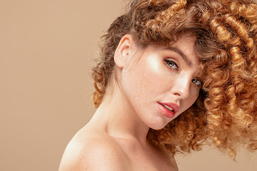 Redhair natural woman with freckles.