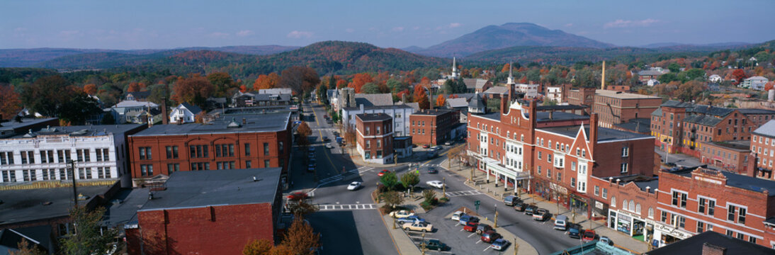 This is a panorama view from the Bell Tower in Claremont. It shows a typical scene from small town America. The buildings are mostly made from red brick. We see fall foliage in the background.