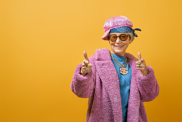 senior woman on color background.