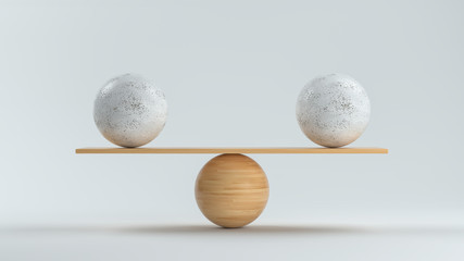 wooden scale balancing two big balls in front white background