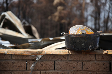 A cooking pot is seen at the rubble of a property damaged by bushfires in Kangaroo Valley, Australia