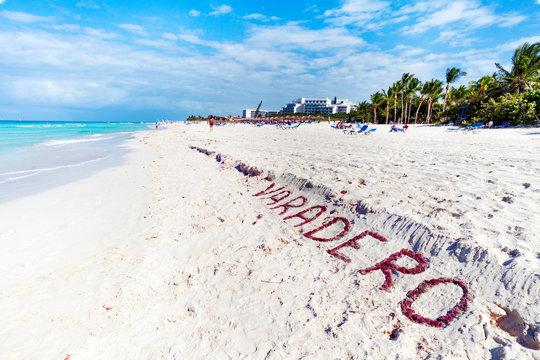 VARADERO written on a sandy beach as ocean. Varadero, Cuba. name of the resort town on white sand lined with seaweed