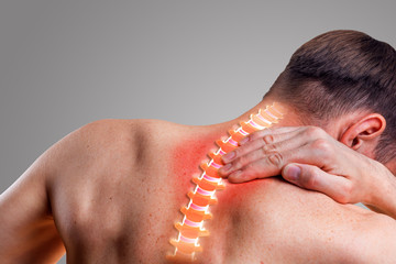 Pain in the cervical spine. Symptom of cervical chondrosis. Inflammation of the vertebra. On a gray background.