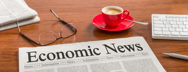 A newspaper on a wooden desk - Economic News