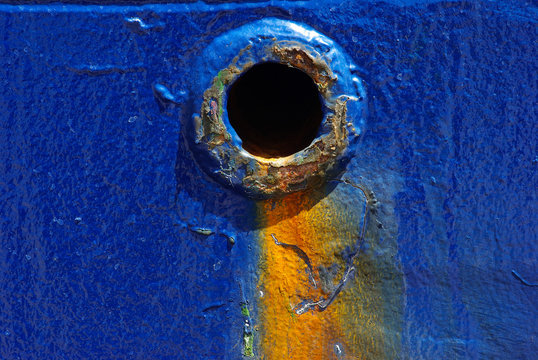 Scupper hole for water drainage water from main deck of the cargo ship