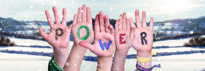 Children Hands Building Colorful Word Power. White Winter Landscape With Snow As Background