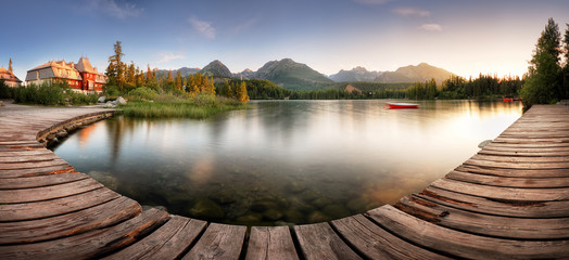 Wall Murals Salmon Landscape Panorama of Mountain lake Strbske pleso in National Park High Tatra, Slovakia, Europe at sunrise