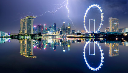 Fotomurales - Singapore at night with storm and lightning bolt