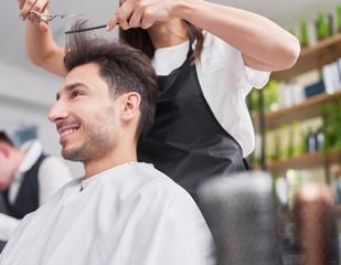 Male customer looking on cutting hair