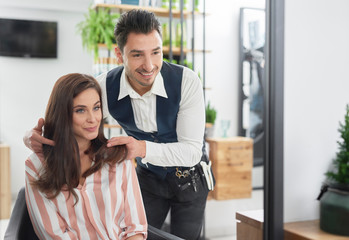 Portrait of hairstylist and female customer