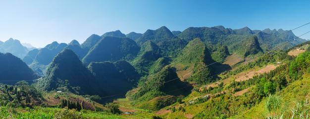 Wall Murals Blue Ha Giang karst geopark mountain landscape in North Vietnam. Winding road in stunning scenery. Ha Giang motorbike loop, famous travel destination bikers easy riders.