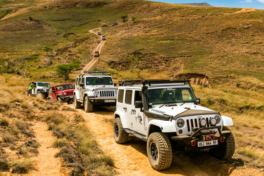 Harrismith, South Africa - October 03, 2015: Jeep 4x4 Vehicles on a Dirt Road in the Drakensberg