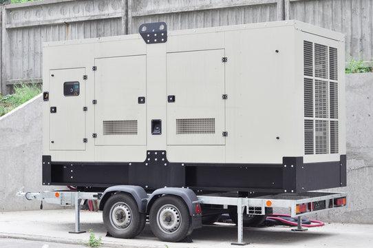 Industrial generator power. Mobile diesel backup generator on caravan wheels.  Backup power supply generator for emergency.