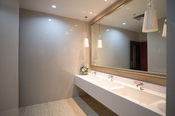 public empty restroom with washstands mirror,public toilet