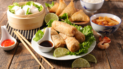 assorted of asian food- spring roll, noodles soup, dim sum