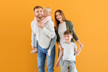 Portrait of happy family on color background